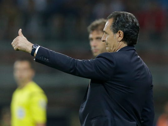 Italy coach Cesare Prandelli gives the thumbs up during a friendly World Cup preparation soccer match between Italy and Luxembourg in Perugia, Italy, Wednesday, June 4, 2014. Italy opens its Brazilian World Cup campaign against England in Group D on June 14 then faces Costa Rica on June 20 and Uruguay on June 24. (AP Photo/Luca Bruno)