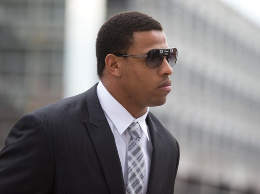 Carolina Panthers' defensive end Greg Hardy arrives at the Mecklenburg County Courthouse on the first day of his domestic violence appeal trial in Charlotte, N.C., Monday, Feb. 9, 2015. Hardy was convicted on two counts of domestic violence in a bench trial last summer and only played one game in 2014. (AP Photo/Chris Keane)