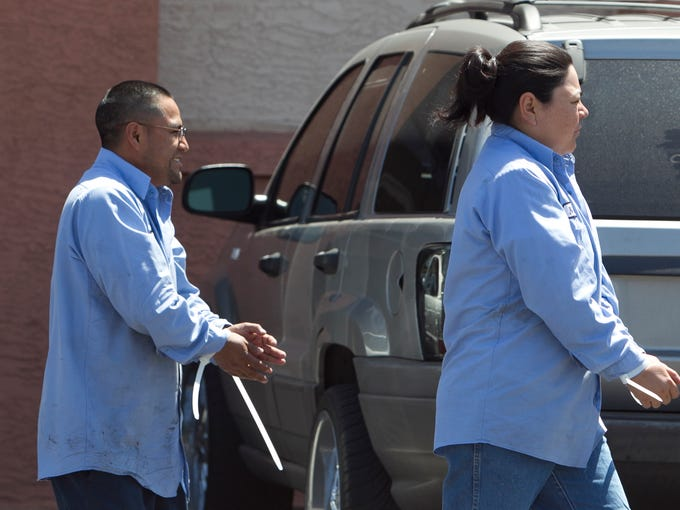 Two alleged illegal immigrants are hand cuffed with
