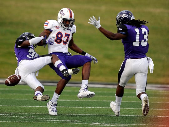 Abilene Christian cornerback Adonis Davis (39) breaks up a pass intended for Northwestern State wide receiver William Mafi during the first quarter of the Wildcats' game on Saturday, Nov. 5, 2016, at Shotwell Stadium.