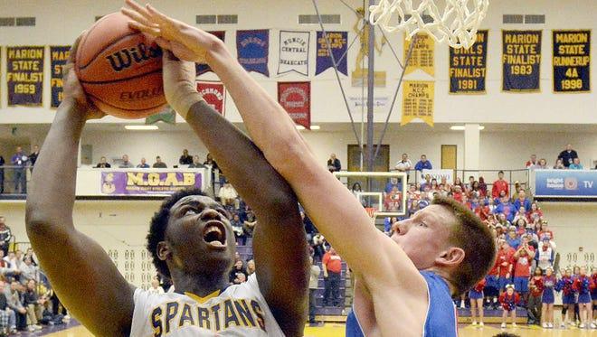 Caleb Swanigan of Homestead is fouled on the shot by Erik Bowen of Kokomo, 3rd quarter of the 4A regional in Marion, Saturday.    Samuel Hoffman/ The Ft Wayne Journal Gazette