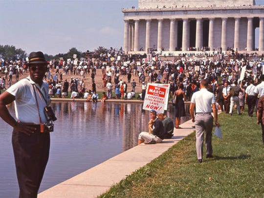 "This image released by Magnolia Pictures shows people gathering at the Lincoln Memorial for the March on Washington, featured in the film, ""I Am Not Your Negro."" In Raoul Peck's Oscar-nominated documentary, James Baldwin's searing observations on race and America are resurrected for today. Peck and others say Baldwin's words could hardly be more urgent."