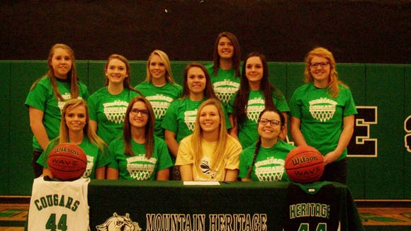 Mountain Heritage senior Destiny Elkins has signed to play college basketball for Montreat.