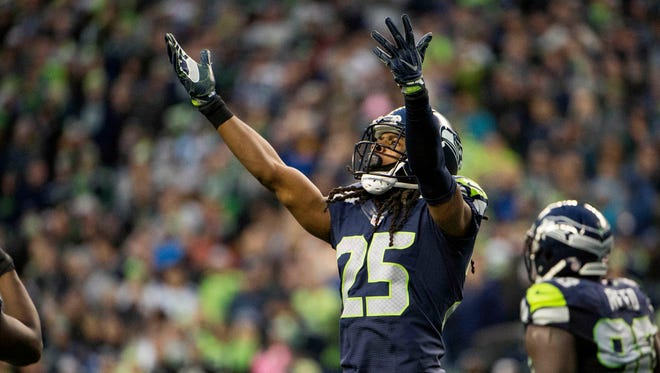 Seattle Seahawks cornerback Richard Sherman (25) encourages fans during the fourth quarter in a game against the Philadelphia Eagles at CenturyLink Field.