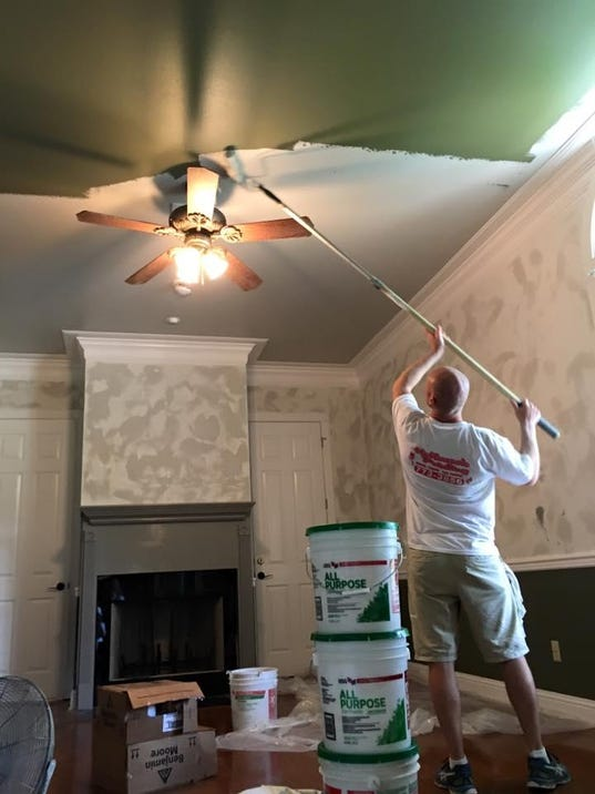 Chad painting a ceiling