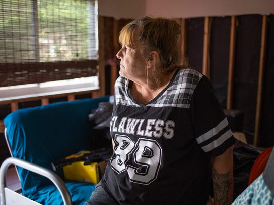 On Friday, Dec. 8, 2017, Lori Malone recounts damage done to her property in Bonita Springs by Hurricane Irma.