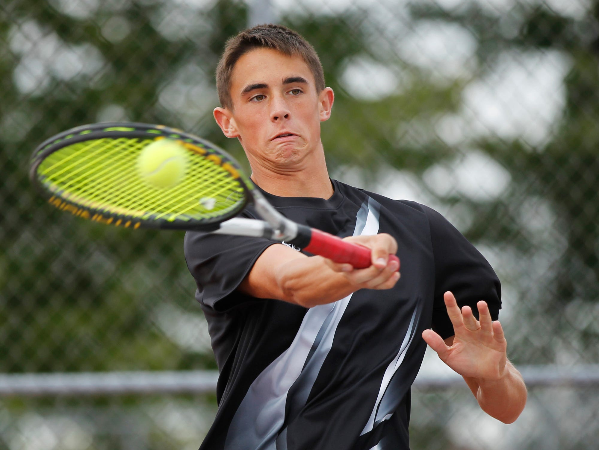 Lafayette Jeff's Jack Moulton with a return against West Lafayette's Ryan Hollis in No. 1 singles during the boys tennis sectional championship Friday, October 2, 2015, at Cumberland Courts in West Lafayette.