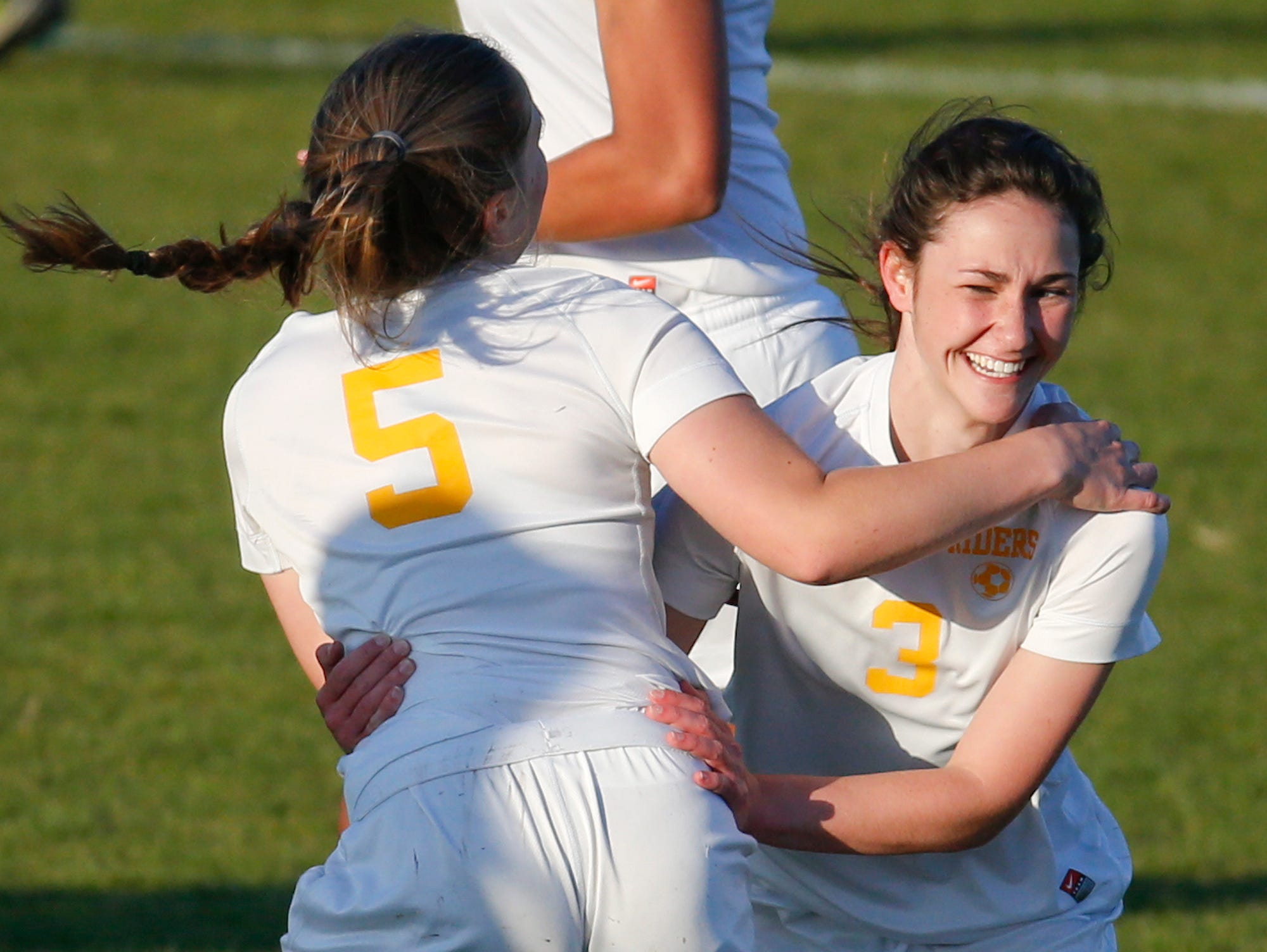 Caesar Rodney's Lynsy Gruwell (left) celebrates with Aleya Cummings after the first of Cummings' two goals on Friday night. No. 2 CR edged No. 3 Charter of Wilmington 2-1 in a Division I matchup.