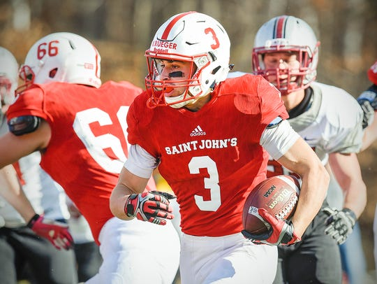 St. John's running back Dusty Krueger takes the ball