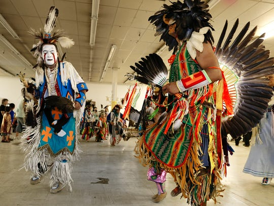 Marvin Farmer of Browning, left, and Doug Pierre of Flathead dance at the Little Shell traditional powwow in Great Falls.