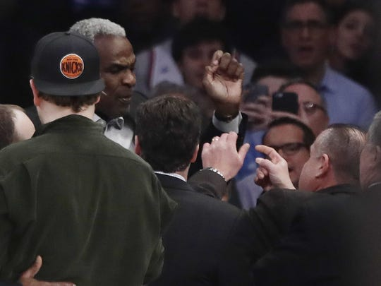 Former Knicks player Charles Oakley said Tuesday, Feb. 14, 2017, he wants a public apology before he returns to Madison Square Garden after Knicks owner James Dolan lifted the Garden ban he had placed on Oakley earlier Tuesday. Oakley, pictured, exchanging words with a security guard during the first half of an NBA basketball game between the Knicks and the LA Clippers on Wednesday, Feb. 8, in New York.