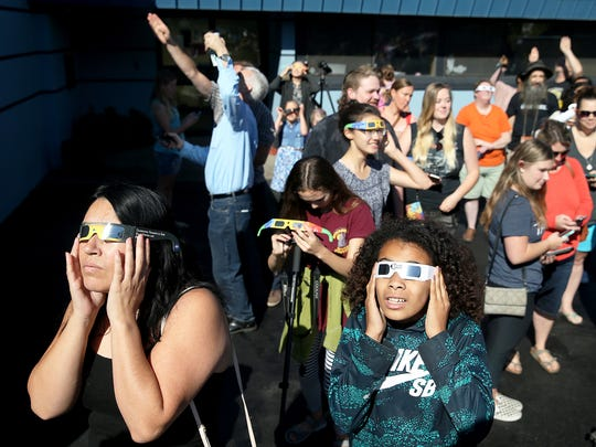 A crowd gathered at the Pacific Planetarium in downtown Bremerton on Monday to watch the Great American Eclipse.