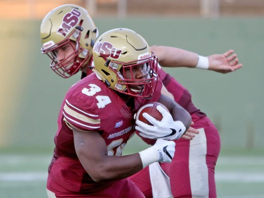Midwestern State running back Vincent Johnson takes