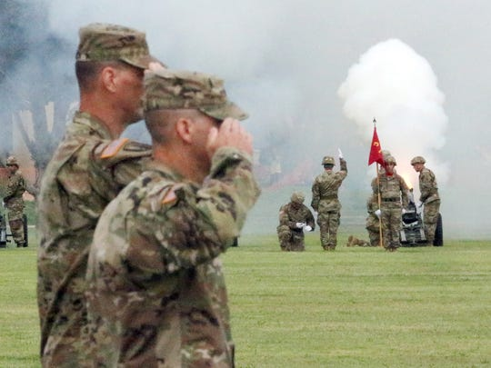 Incoming and outgoing commanders of the 1st Armored Division and Fort Bliss salute as a gun salute takes place during a Change of Command Ceremony Thursday at Fort Bliss.