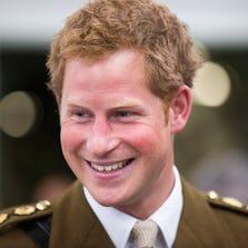 DEVONPORT, UNITED KINGDOM - AUGUST 02:  Prince Harry visits The Royal Marines Tamar on August 2, 2013 in Devonport, England.
