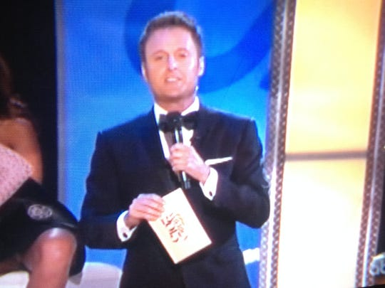 """Miss Nebraska Megan Swanson is caught flashing the Atlantic City crowd while Miss America co-host Chris Harrison was yakking about how the judges will be looking at """"personal style"""" during the evening gown portion."""
