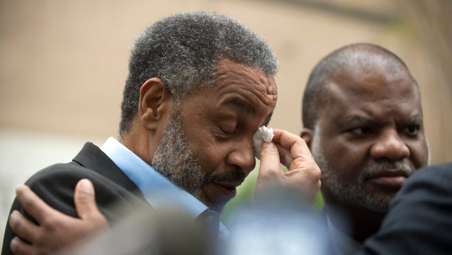 Anthony Ray Hinton wipes away tears outside the Jefferson County Jail in Birmingham, Ala., upon his release April 3, 2015, after serving 28 years on death row for two 1985 murders during restaurant robberies.