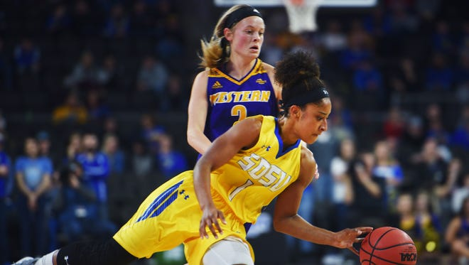 SDSU's Alexis Alexander goes against Western Illinois defense during the Summit League basketball tournament Monday, March 5, at the Denny Sanford Premier Center in Sioux Falls.