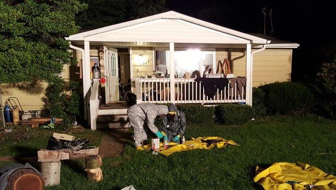 Officers investigate a suspected meth lab Monday night on Cortland Street in Waynesboro.