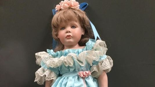 """Police say the woman who left dolls on the doorsteps of families with daughters who resemble them meant the gesture out of """"good will."""" Department Twitter)"""