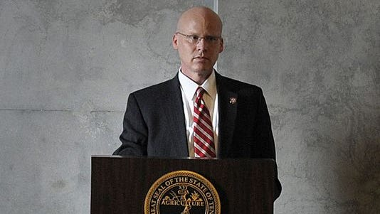 Darin Gordon, director of TennCare, speaks to legislators in the legislative lounge at the Capitol in February.