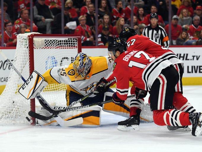 Nashville Predators goalie Pekka Rinne (35) defends