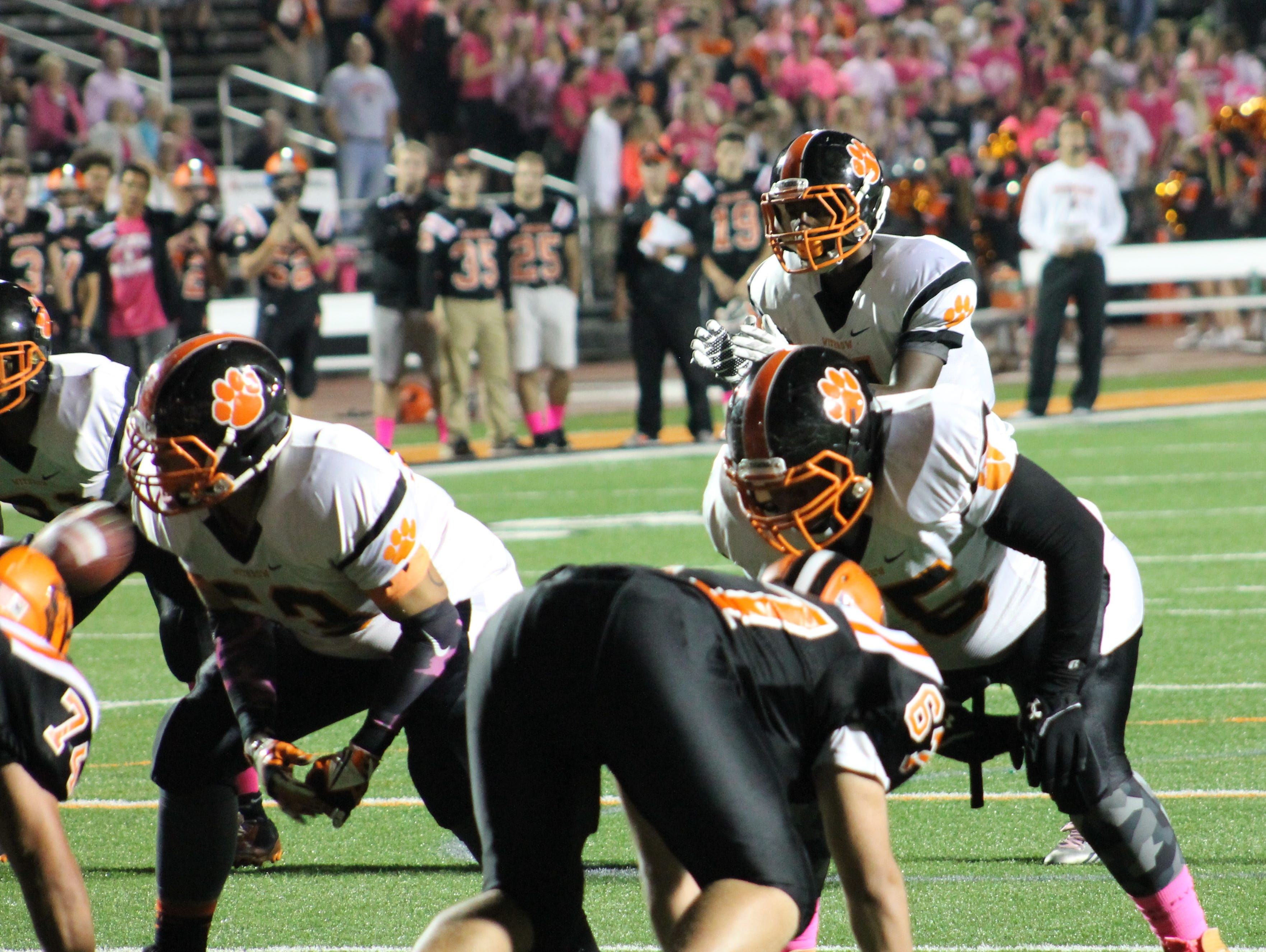 Withrow senior Rashaun O'Neal takes the direct snap for the Tigers against Anderson Oct. 23.