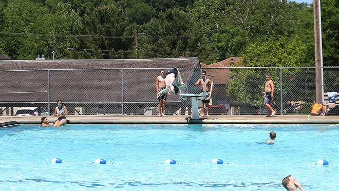 The Newcomerstown swimming pool opened Monday with some restrictions due to COVID-19.