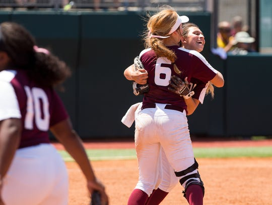 Vernon's Caitlin Brints hugs pitcher Jade Guzman after