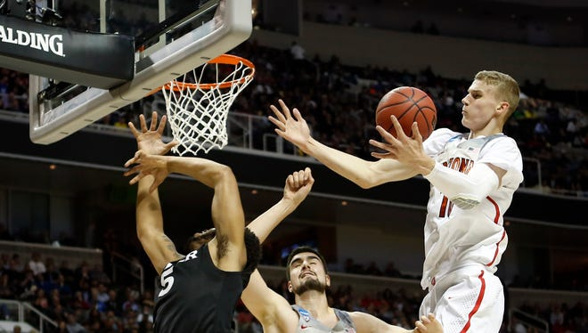 Mar 23, 2017; San Jose, CA, USA; Arizona Wildcats forward Lauri Markkanen (right) controls a rebound with teammate Dusan Ristic (14) against Xavier Musketeers guard Trevon Bluiett (5) in the first half during the semifinals of the West Regional of the 2017 NCAA Tournament at SAP Center.