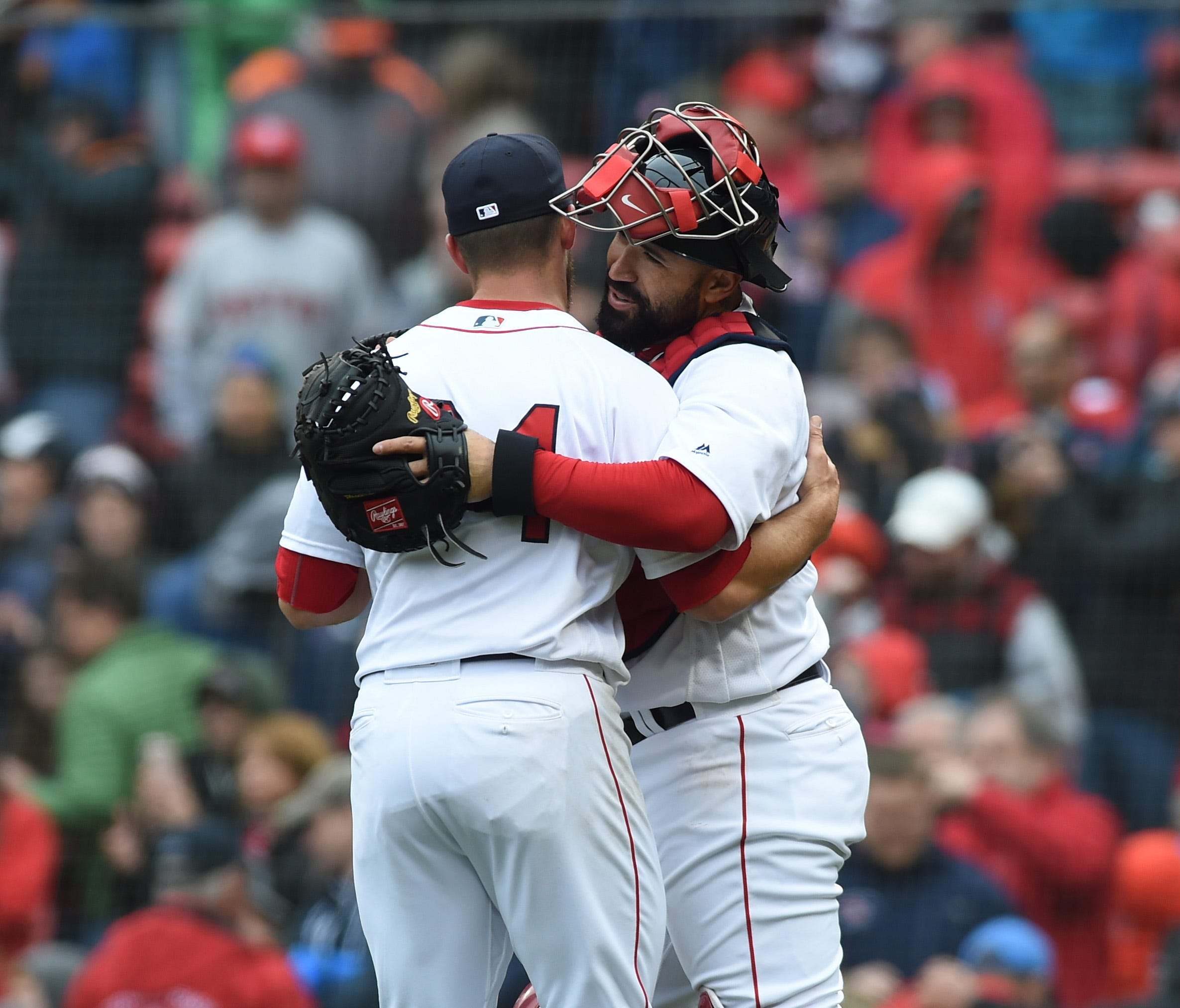 Red Sox relief pitcher Marcus Walden is congratulated by catcher Sandy Leon after a win.