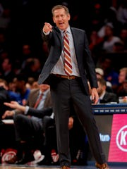 New York Knicks head coach Jeff Hornacek motions to players during a break in play of a preseason NBA basketball game.