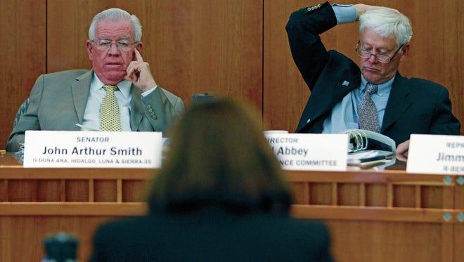 Democratic Senator John Arthur Smith and David Abbey, Director of the LFC staff, listen to testimony during a hearing last year at the New Mexico Legislature.