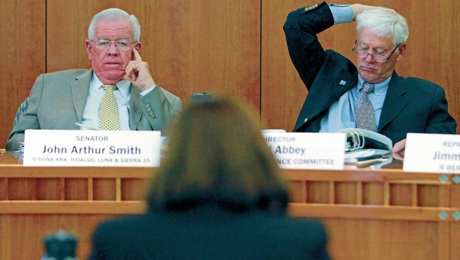 Sen. John Arthur Smith (D-Deming), left, said anything that has fiscal impact should go through the Legislative Finance Committee which he chairs.
