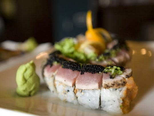 A Blue Koi specialty roll is the Black Diamond, which includes seared black pepper tuna, spicy scallops and scallions, topped off with a row of black caviar.