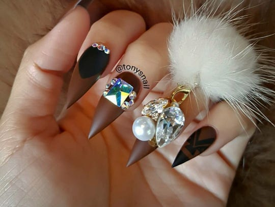These stiletto nails get a bit of bedazzling from Tony