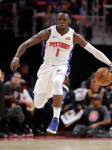 Detroit Pistons guard Reggie Jackson brings the ball