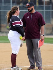 McMurry coach David McNally talks to starting pitcher Cheyenne West (23) during the War Hawks' 7-6 win at Hardin-Simmons on Tuesday, Feb. 13, 2018.