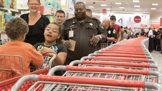 Law enforcement officers and Muncie area school children were brought together on Saturday morning for a back-to-school shopping trip to Target. The kids were given $50 to spend on whatever they liked, with most of them spending it on school supplies, clothes and shoes.