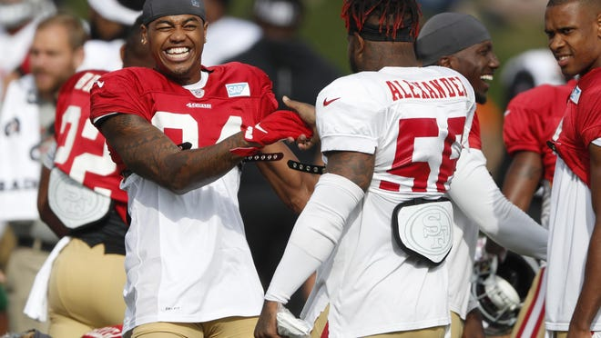 San Francisco 49ers wide receiver Kendrick Bourne, left, jokes with middle linebacker Kwon Alexander during a combined NFL football training camp with the Denver Broncos at the Broncos' headquarters Friday, Aug. 16, 2019, in Englewood, Colo.