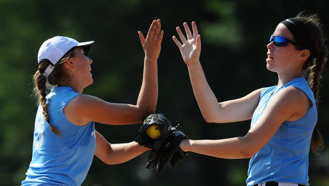Delsea's Anastasia Reale, left, high fives Gloucester Catholic's Kiera Regan after making an out for Tri-Cape against Inter-AC during a Carpenter Cup softball game at FDR Park in Philadelphia, Pa. 6.22.16.