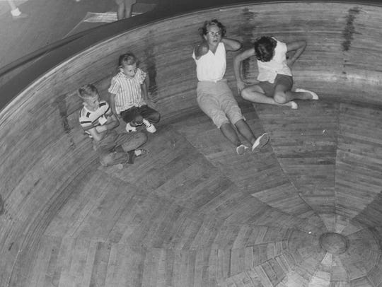 This photo of riders on the wooden centrifugal force