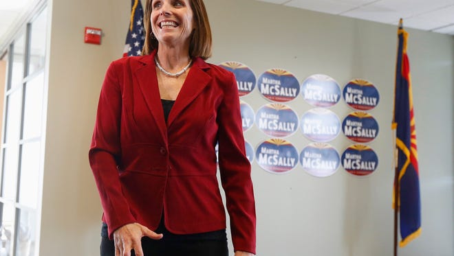 Republican Martha McSally smiles after learning that a recount gave her a congressional victory against Democratic incumbent Rep. Ron Barber on Dec. 17, 2014.