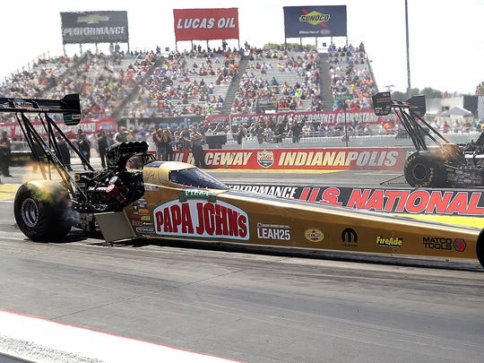 Top Fuel drivers Leah Pritchett,left, races SteveTorrence,right, race during the Chevrolet Performance NHRA U.S. Nationals Sunday, September 4, 2016, afternoon at Lucas Oil Raceway in Brownsburg.