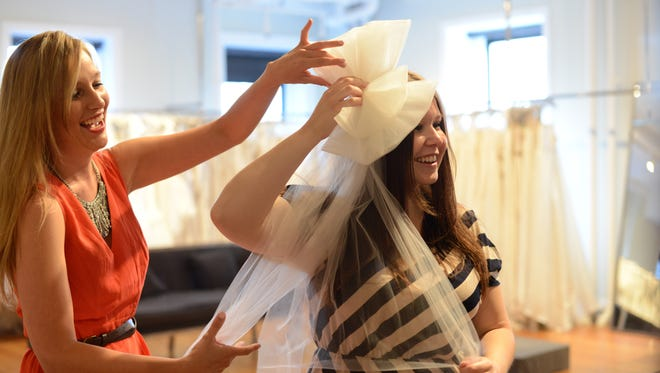 Jen Glantz left, helps Ashley Blanchard shop for bridal accessories at Gabriella New York Bridal Salon.