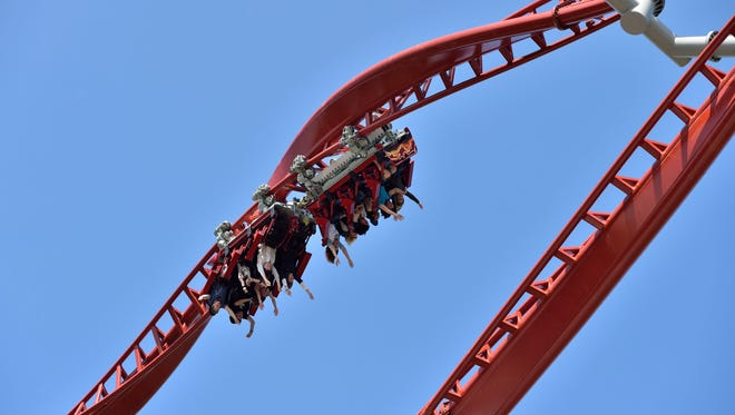 """Visitors ride the new roller coaster """"Sky Screamer"""" in the Holiday Park in Hassloch, Germany, on April 11, 2014."""