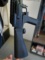 A bump stock device that fits on a semi-automatic rifle