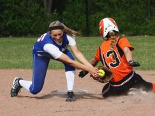 Amber Swisher tags out a Belleville runner during a