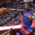 Apr 17, 2016; Cleveland, OH, USA; Detroit Pistons guard Kentavious Caldwell-Pope (5) makes a pass as Cleveland Cavaliers guard J.R. Smith (5) defends during the first quarter in game one of the first round of the NBA Playoffs at Quicken Loans Arena.