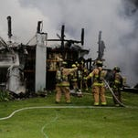Firefighters from four crews worked to contain a barn fire in the 5900 block of Indiana 26 East Wednesday, July 1.